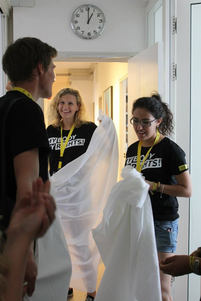 "In the process of making a ""wedding dress"" with the help of Emil and Signe for our public actions in Copenhagen on the 3rd day of the conference. Credits: Marte Nygaard Lind"