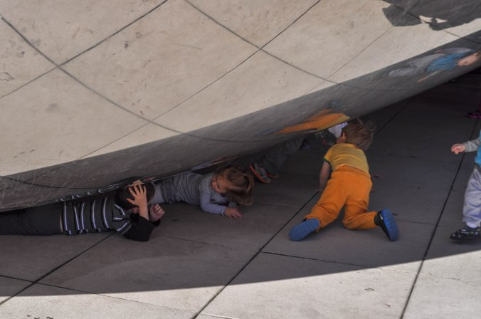 Little kids under the Bean.