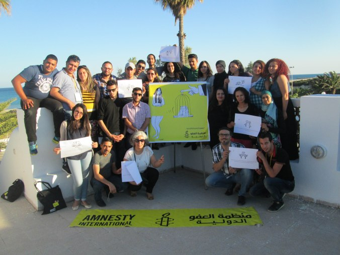 All the participants and organizers with the artwork of Tunisia artist Tawfiq Omar. Photo credits: Nada El Kashef